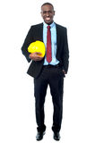 Construction engineer holding hard hat Stock Photo