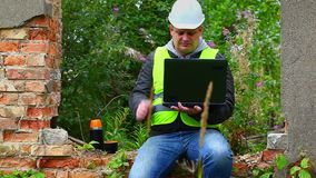 Construction Engineer with PC and tea cap at outdoors stock video