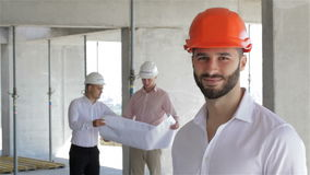 Construction engineer poses at the building under construction stock video