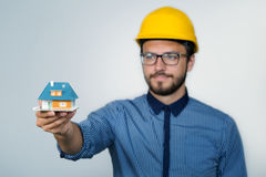 Construction engineer showing small house model Royalty Free Stock Images