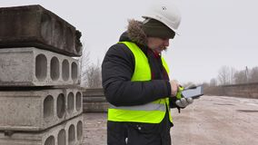 Construction engineer with tablet PC numbering stock video footage