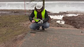 Construction engineer take pictures of pavement stock video footage
