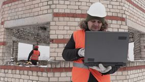 Construction engineer using laptop stock video footage
