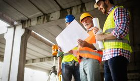 Free Construction Engineer With Foreman Worker Checking Construction Site Royalty Free Stock Image - 160024196