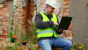 Construction Engineer working with PC stock video footage