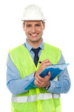 Construction engineer writing on notepad Royalty Free Stock Image