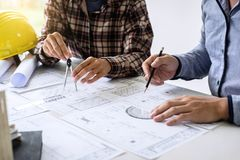 Construction engineering or architect discuss a blueprint while royalty free stock images