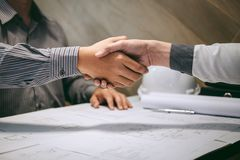 Construction engineering or architect discuss a blueprint while checking information on drawing and sketching, meeting for royalty free stock image