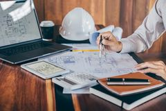 Construction engineering or architect hands working on blueprint inspection in workplace, while checking information drawing and royalty free stock images