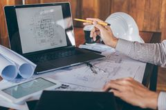 Construction engineering or architect hands working on blueprint inspection in workplace, while checking information drawing and stock photos