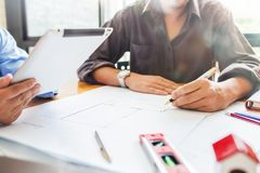 Construction engineering meeting at workplace office working hard modern design new plan on their project architecture concept. royalty free stock photography