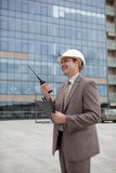 Construction engineering worker/manager on radio Stock Image