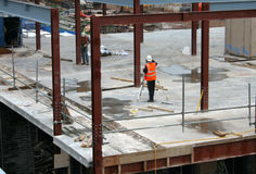 Construction engineers. Engineers at work checking a new building during construction Royalty Free Stock Image