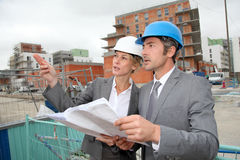 Construction engineers on building site Stock Image