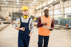 Construction engineers discussing building plan royalty free stock images
