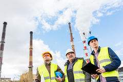 Construction engineers examining thermoelectric power station. Royalty Free Stock Photo