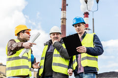 Construction engineers examining thermoelectric power station. Stock Photo