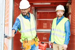 Construction engineers in industrial elevator stock photo