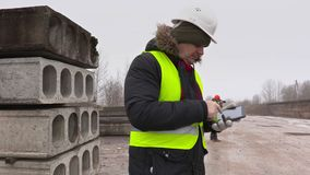 Construction engineers using tablet and professional photo camera stock footage