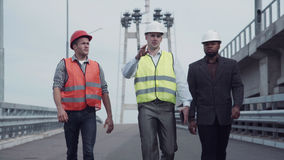 Construction engineers walking on highway ramp royalty free stock photo