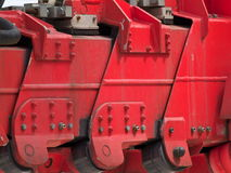Construction equipment. A closeup view of construction equipment, specifically the retracted arm of a heavy duty crane Royalty Free Stock Images