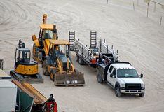 Construction equipment on the beach. Tractors and trucks for new beachfront construction Stock Photography