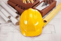 Construction equipment on blueprints Stock Photo