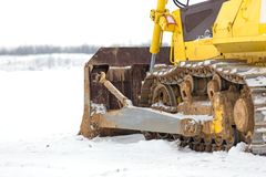 Construction equipment bulldozer in snow Royalty Free Stock Images