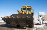 Construction equipment. Earth-moving machine at gas station Stock Images