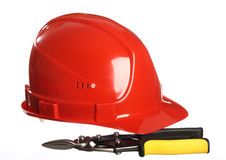 Construction equipment: helmet and snips Royalty Free Stock Photo