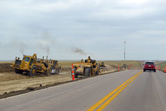 Construction equipment on the highway Royalty Free Stock Photo