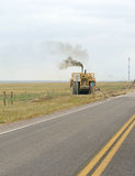 Construction equipment on the highway Stock Photos