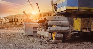 Free Construction Equipment In Construction New Building Background, Excavator With Crane On Construction Site Royalty Free Stock Image - 148213996