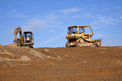 Construction equipment and red clay Stock Photography