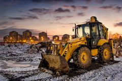 Construction equipment at snowy site Royalty Free Stock Photo