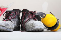 Construction equipment work boots noise muffs Royalty Free Stock Photos