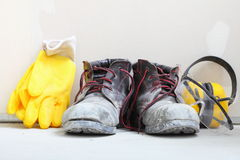 Construction equipment work boots noise muffs Royalty Free Stock Photo