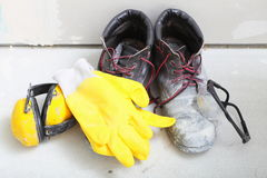 Construction equipment work boots noise muffs. Renovation at home. Construction equipment tools work boots yellow protective noise muffs gloves glasses in Royalty Free Stock Images