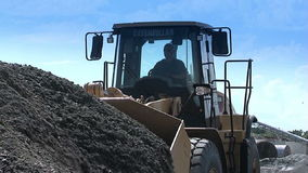 Construction equipment at work. Bulldozers are gaining a scoop rubble. Building. N stock video footage