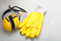 Construction equipment work gloves noise muffs Stock Photo