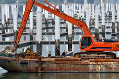Construction equipment working at dock. Construction equipment working at empty dock, shown as special working environment and area, featured of construction Royalty Free Stock Photography