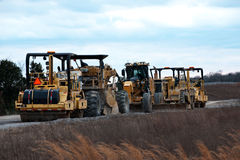 Construction equipment on worksite stock images