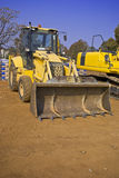 Construction equipment in yard Stock Photography