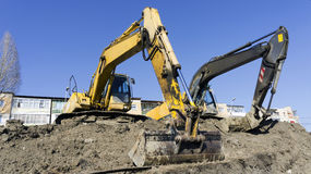 Construction excavator. A construction excavator loader bulldozer stock photos