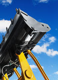 Construction excavator bucket against the sky Royalty Free Stock Photography