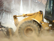 Construction Excavator Pushing Dirt Causing Dust stock photography