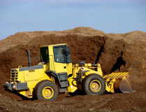 Construction Excavator and Scooper in Pile of Dirt stock images