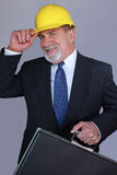 Construction Executive. A smiling construction executive in a yellow hard hat Royalty Free Stock Photos