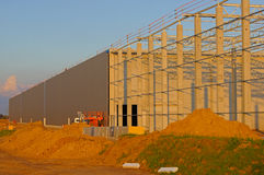 Construction of a factory building. In a commercial area Royalty Free Stock Photo