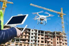 Drone operated by construction female worker on building site Stock Images